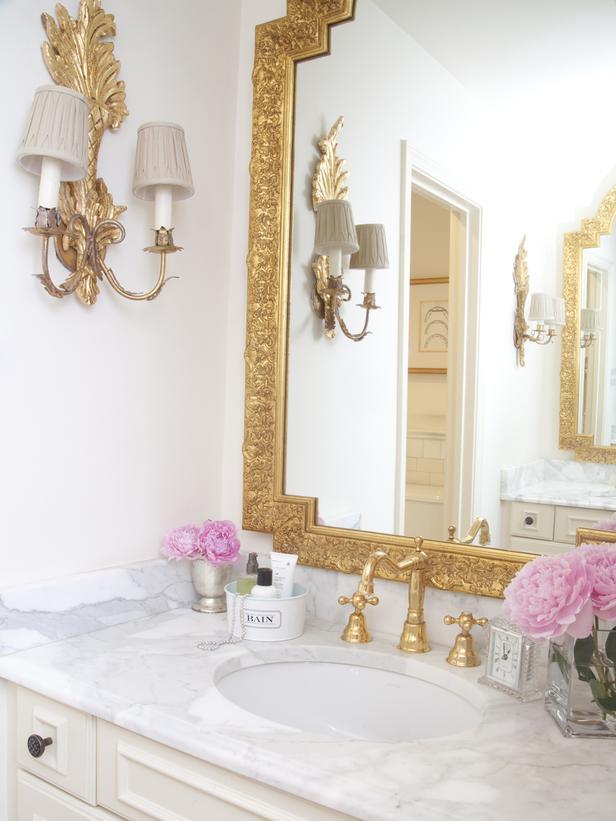 Gilded bathroom mirror