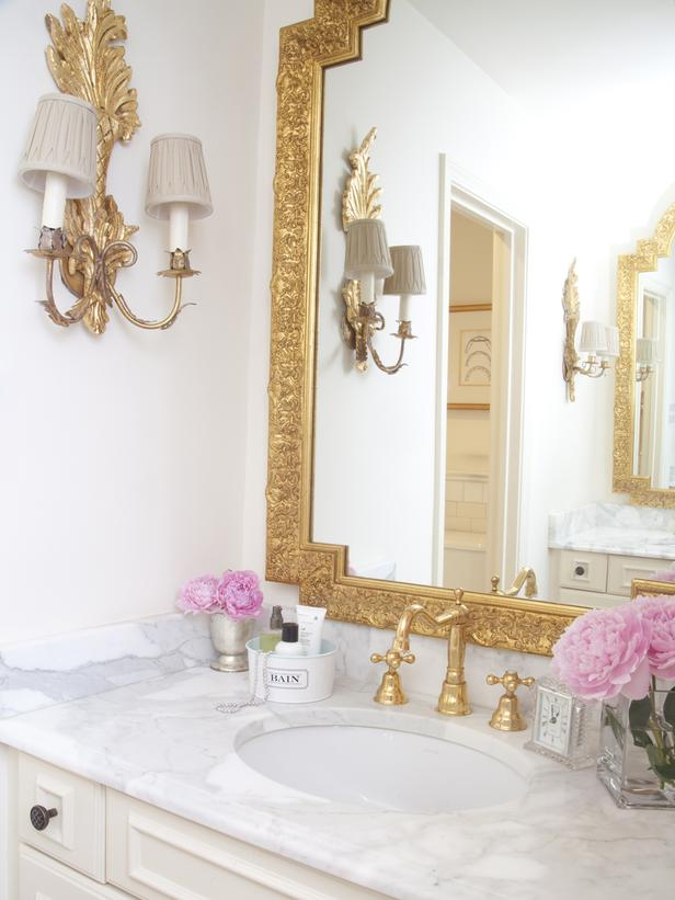 Gilded bathroom mirror