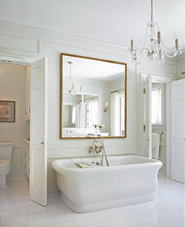 Mirror over bathtub in washroom
