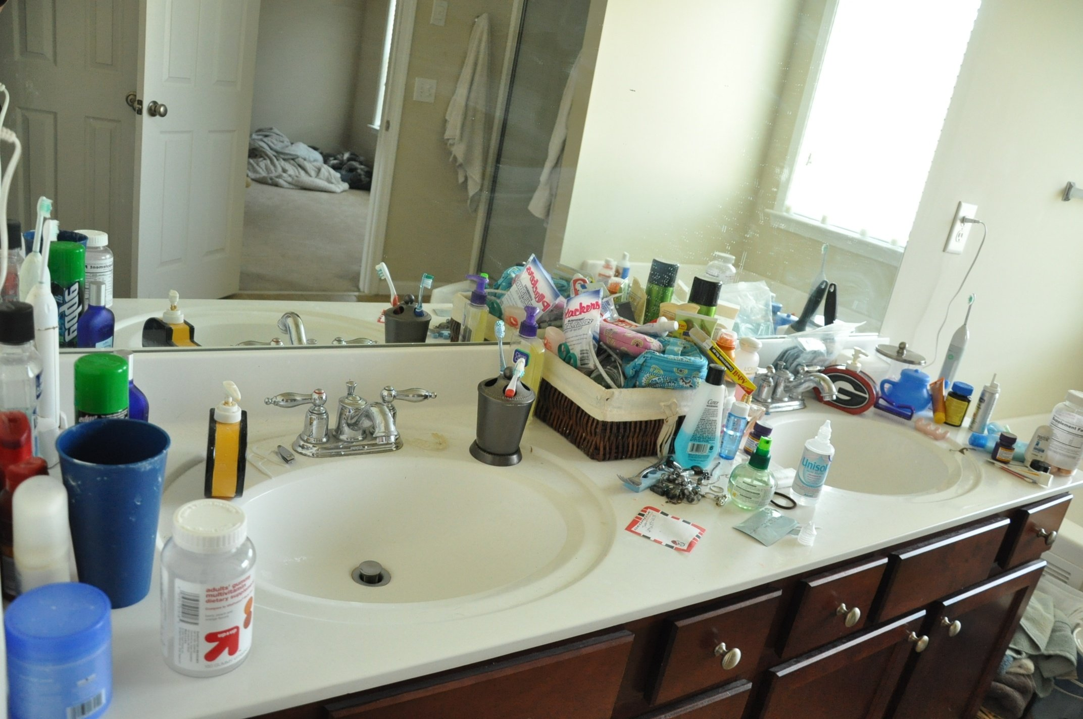 6 Easy Ways to Clear Out Bathroom Clutter This Weekend - Clear the Countertop
