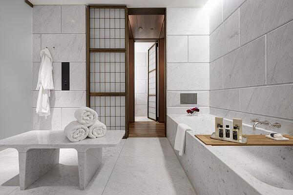 How to Create a Beautiful Hotel Bathroom at Home - Hotel Bathroom With Seating