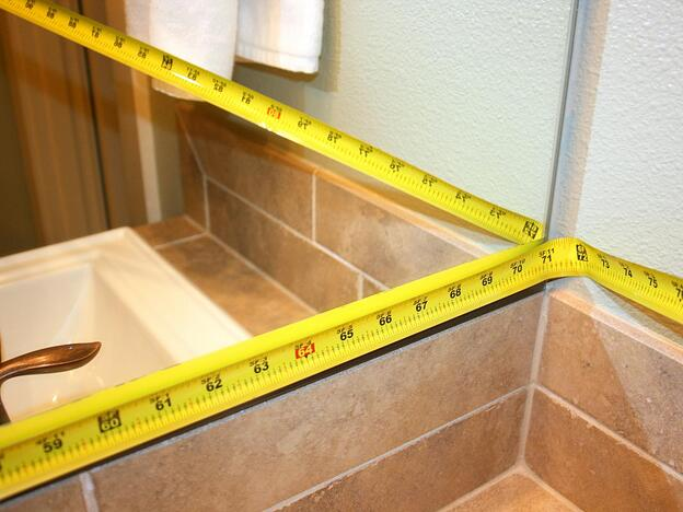 How to Create a DIY Mirror Frame for Your Bathroom - Measure your mirror