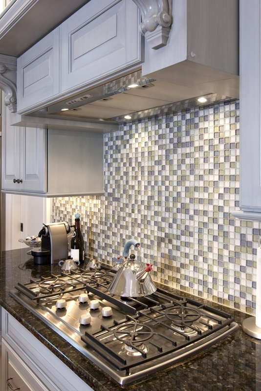 kitchen stove with a backsplash